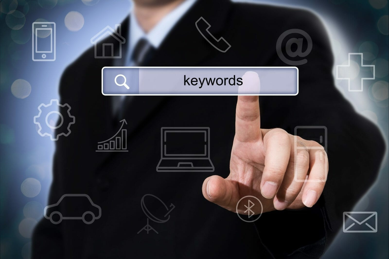 Businessman clicking search field with keywords. Business concept.