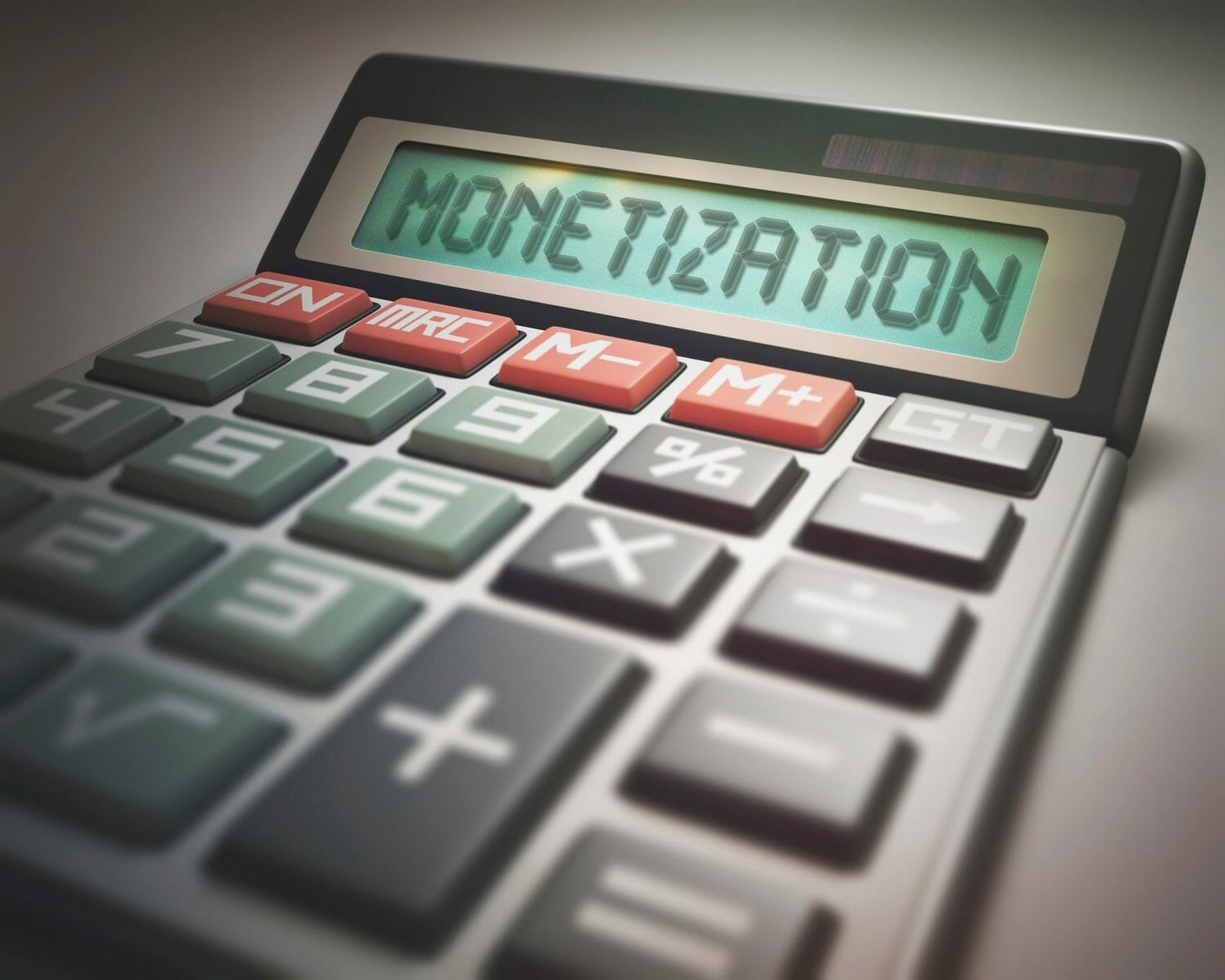 Calculator with the word monetization, illustration.