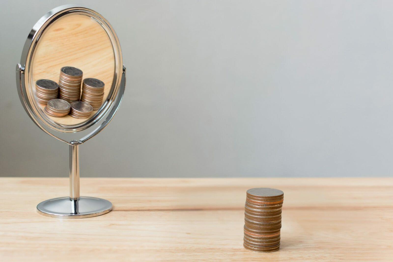 Money mirror reflection, Save money investment concept